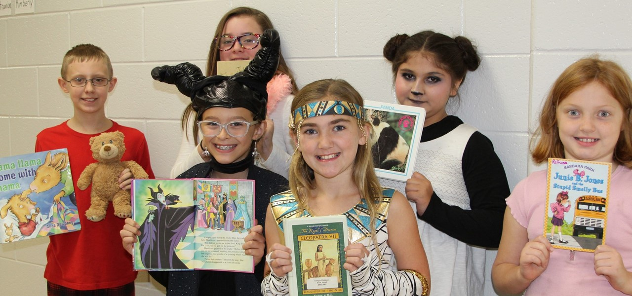 students dress up as book characters for a book character parade