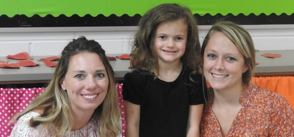 students and their families attend curriculum night