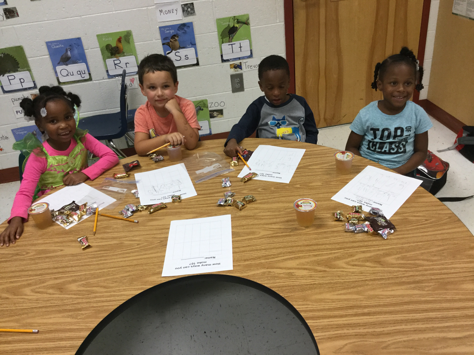 Kindergarten LEAP kids using candy to find different ways to make 10.
