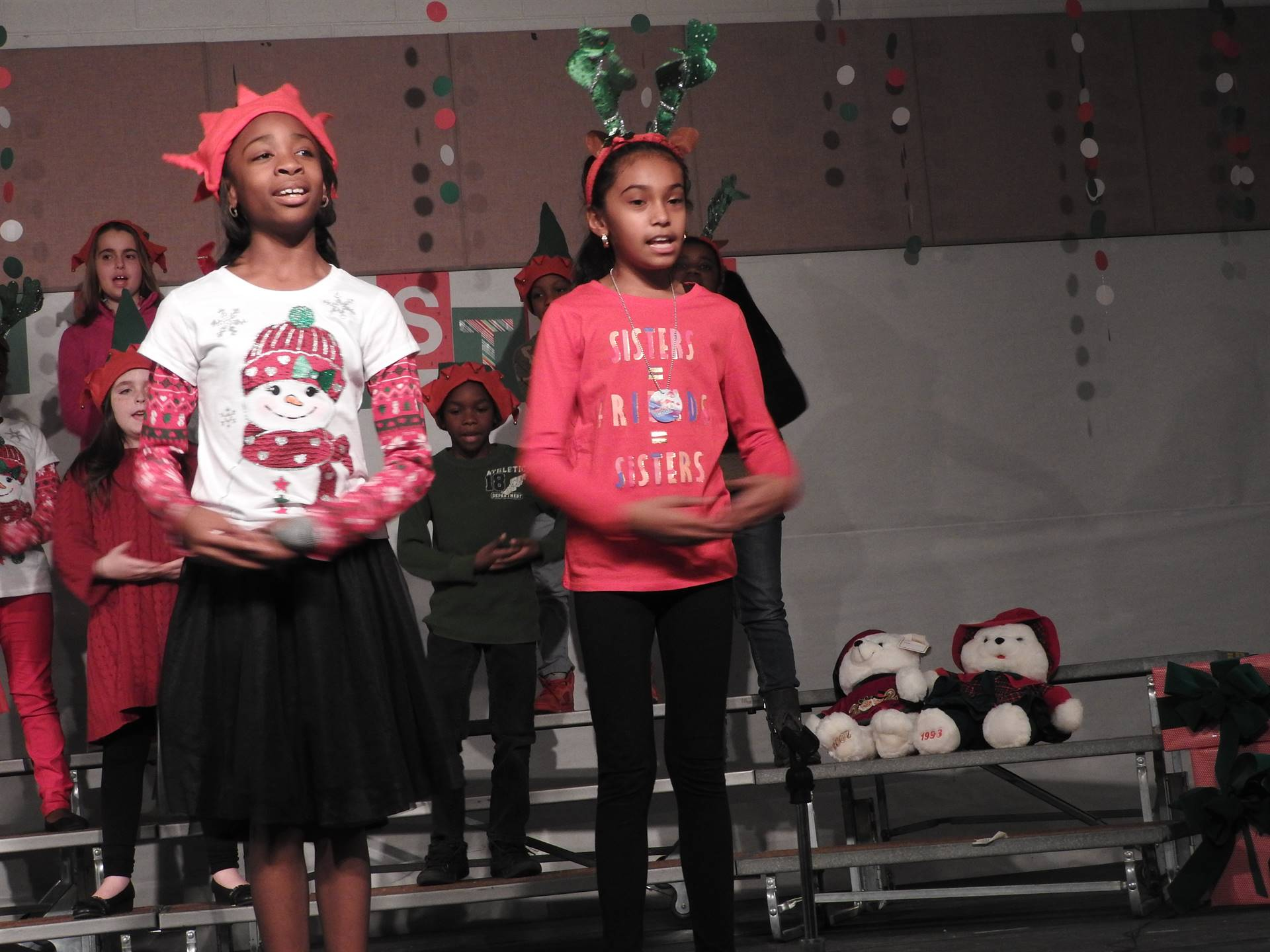two students perform during the LEAP Christmas Literacy program