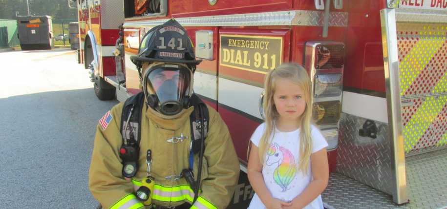 Young student with a fireman