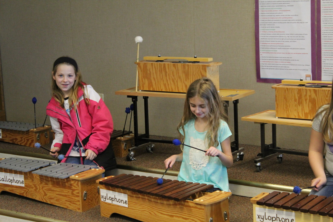 Students playing instruments in music class.