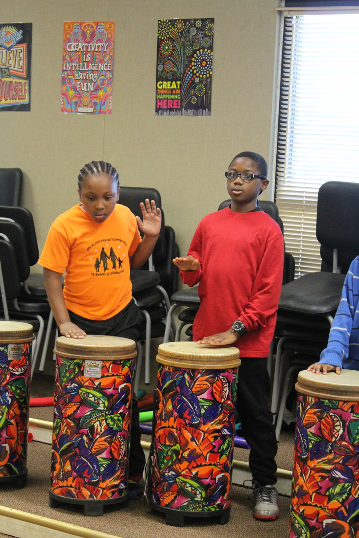 Students playing drums in music class.