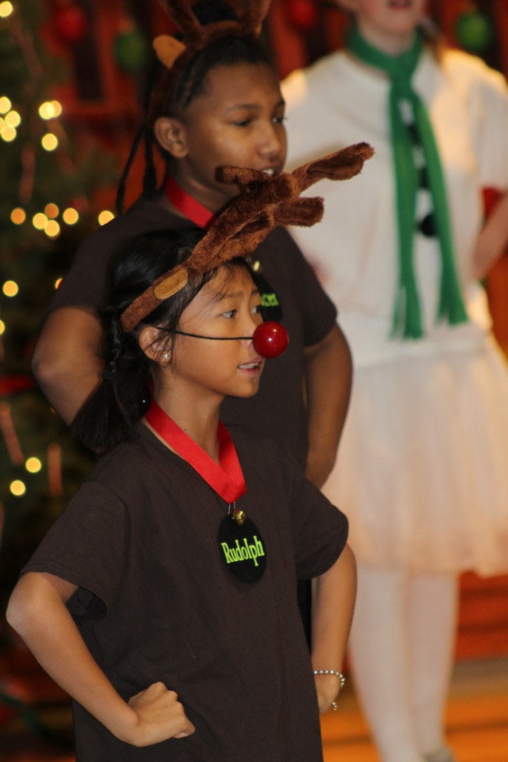 Student dressed as Rudolph in a chorus performance.