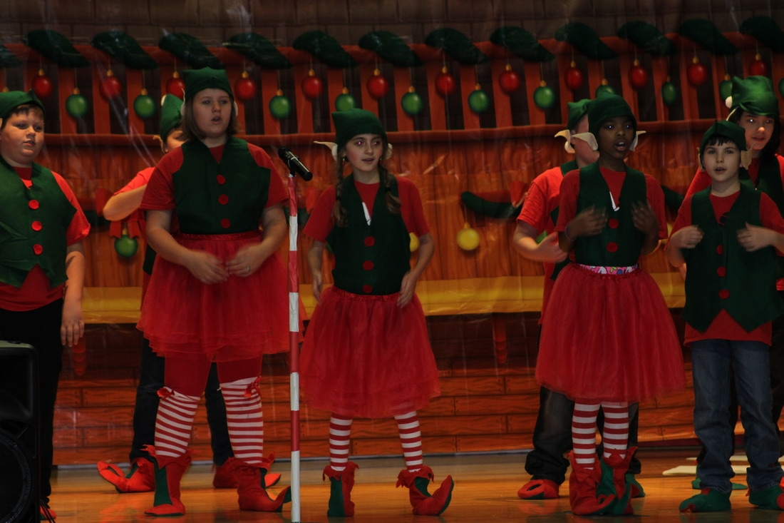 Students dressed as elves in a chorus performance.
