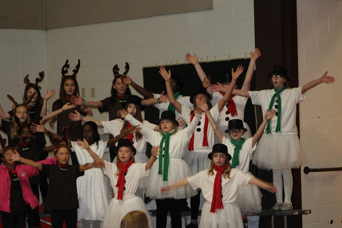 Students singing and dancing in the Christmas performance.