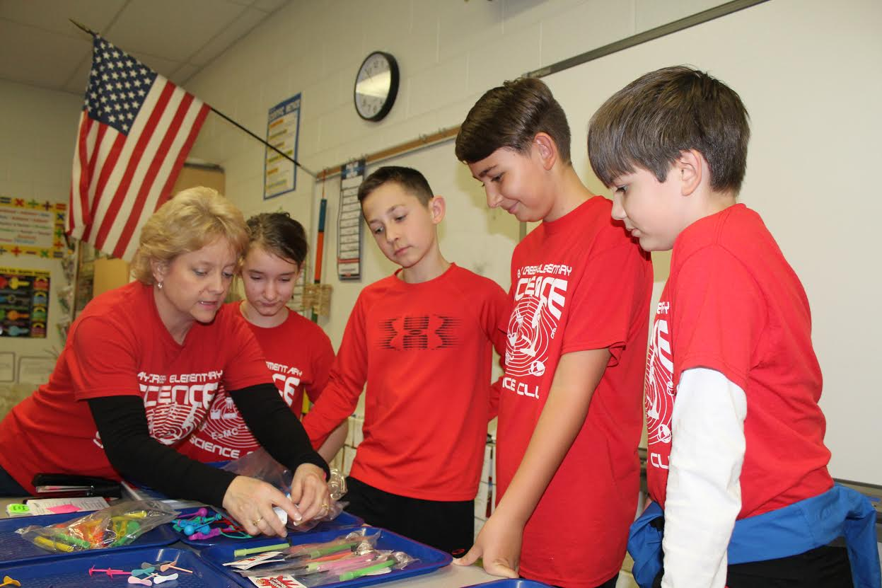 Students working with their advisor on an experiment in Science Club.