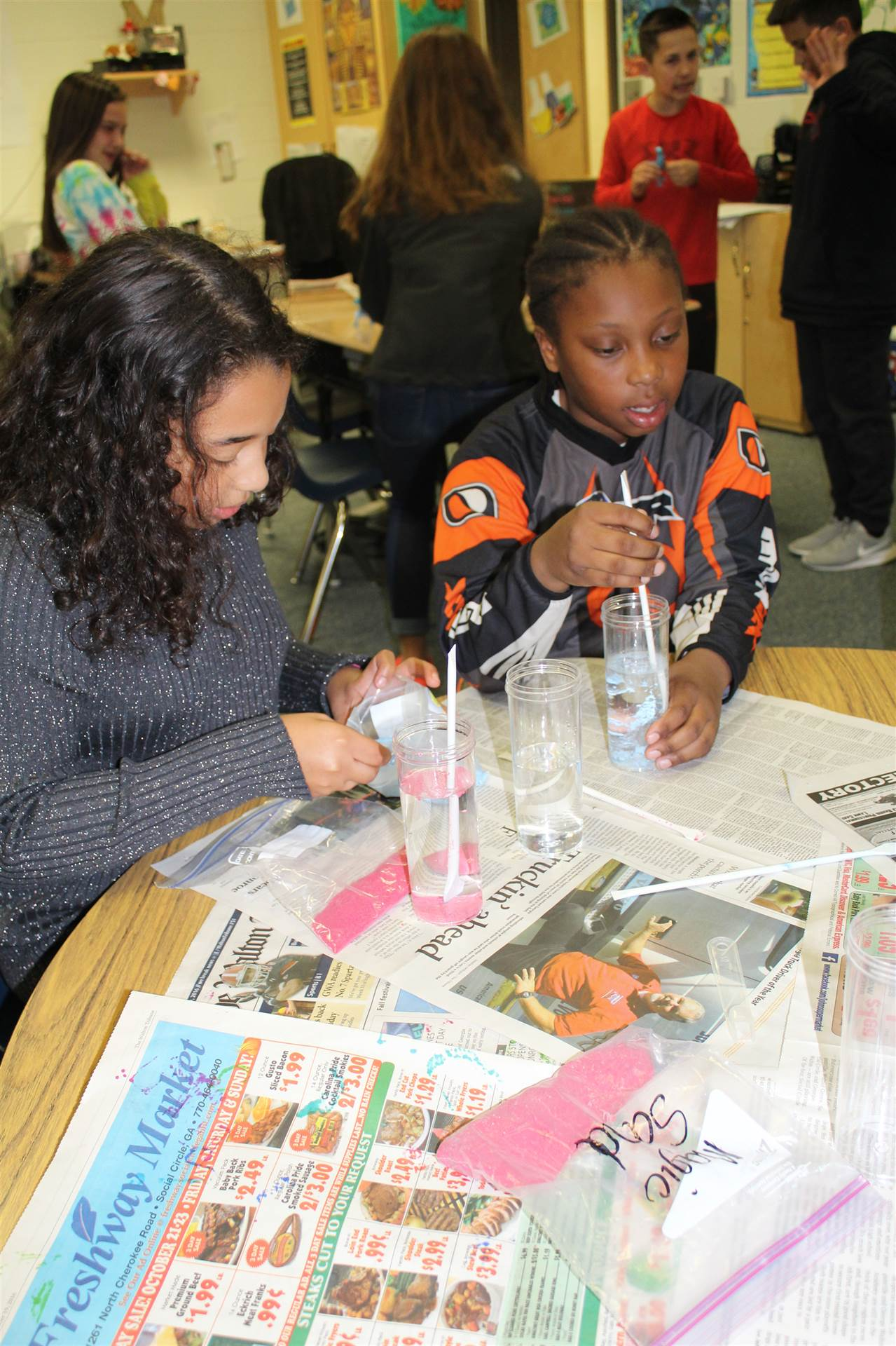 Students doing an experiment in science club.