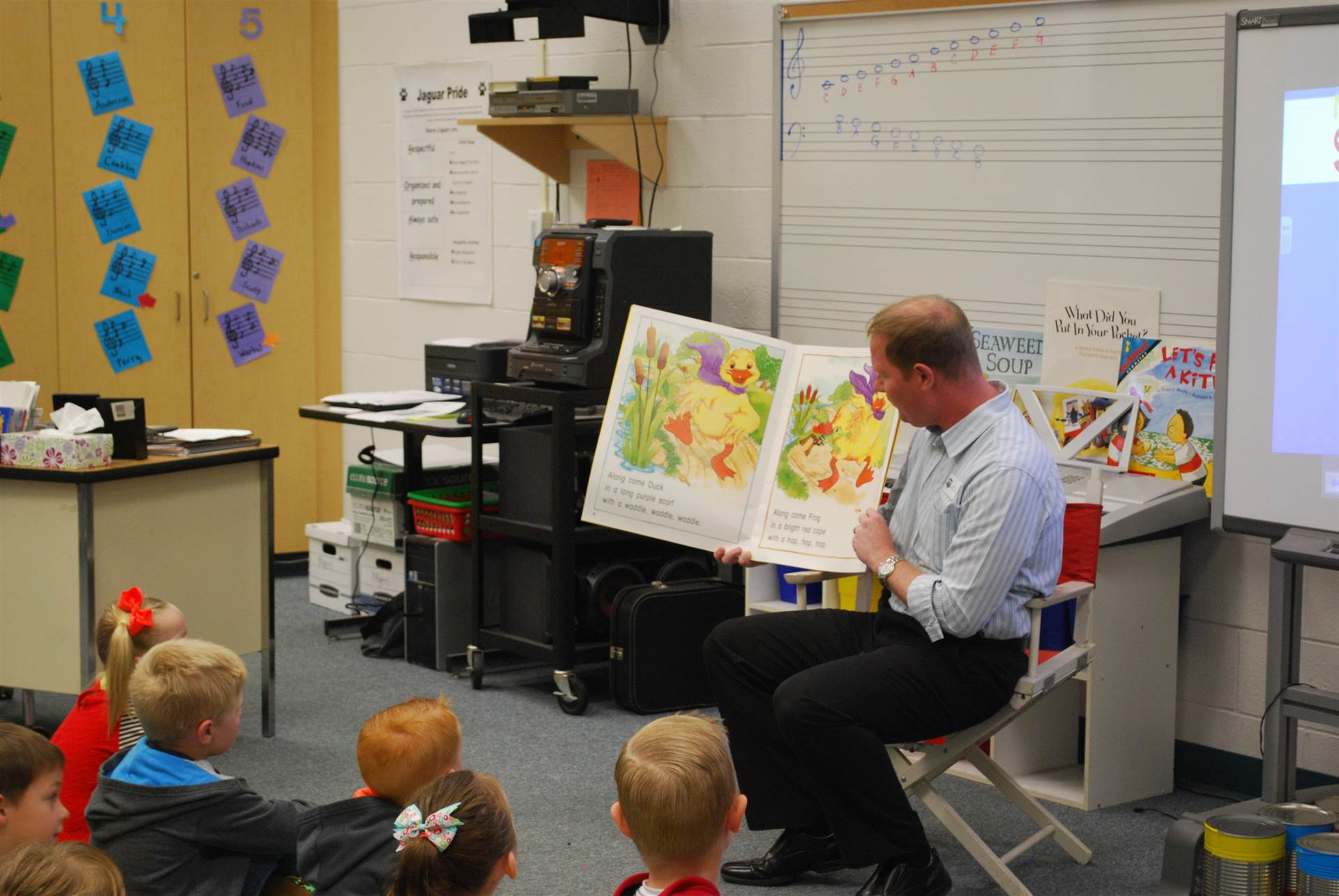 Music teacher reading to students.