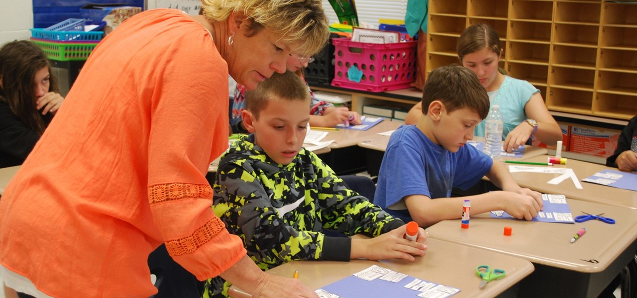 Bay Creek Elementary School Support Person of the Year helping a student in class.