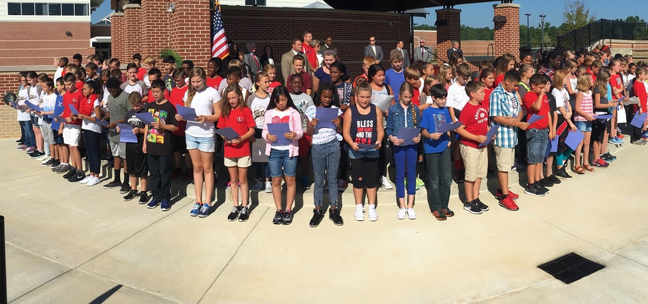 Students singing at the LES Ribbon Cutting Ceremony.