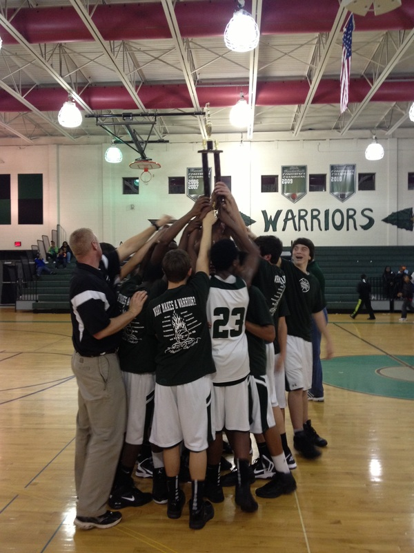 YMS boys team holding up a trophy.