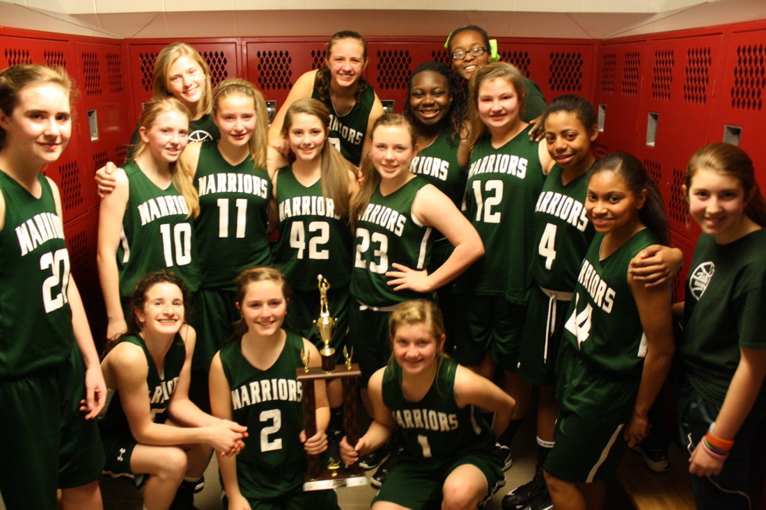 Girls basketball team with a trophy.