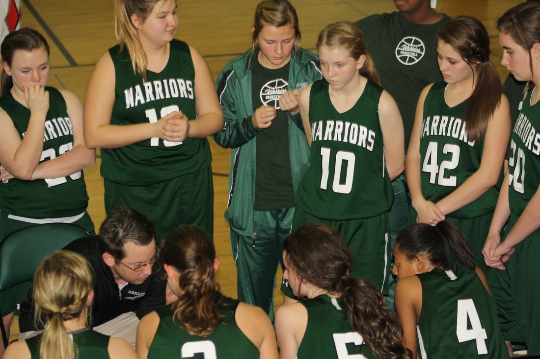 Girls team in a huddle.