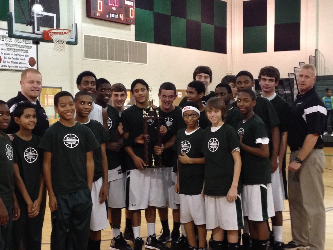 Boys team with a trophy after a game.