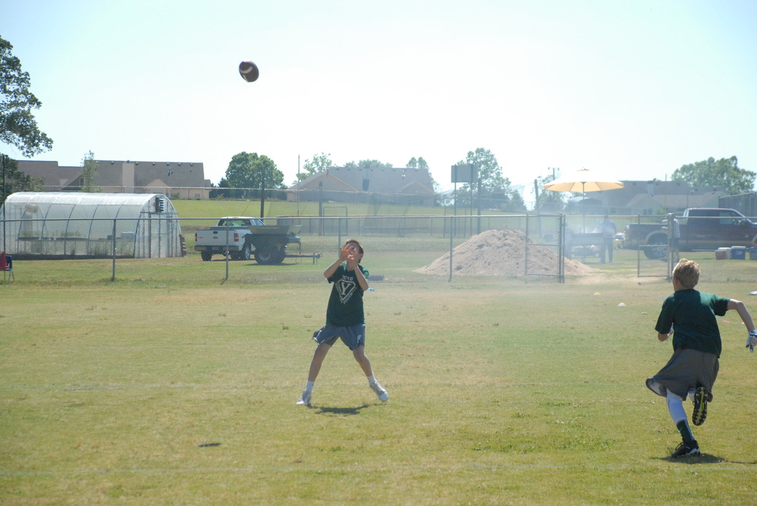 Student catching a football.
