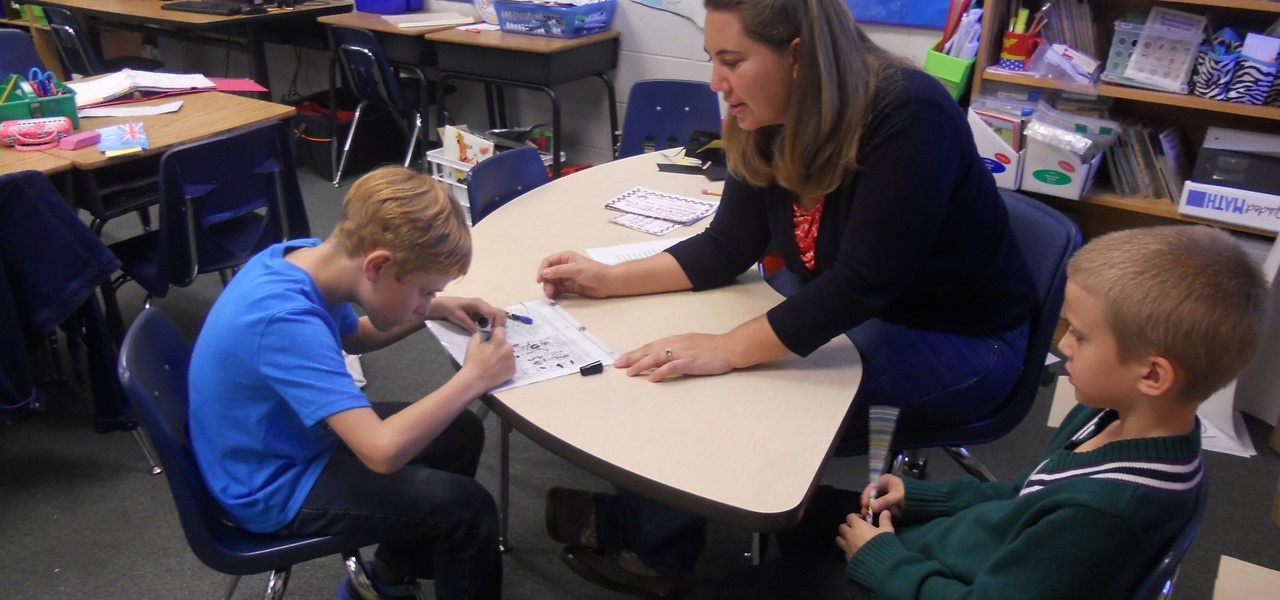 Teacher helping students