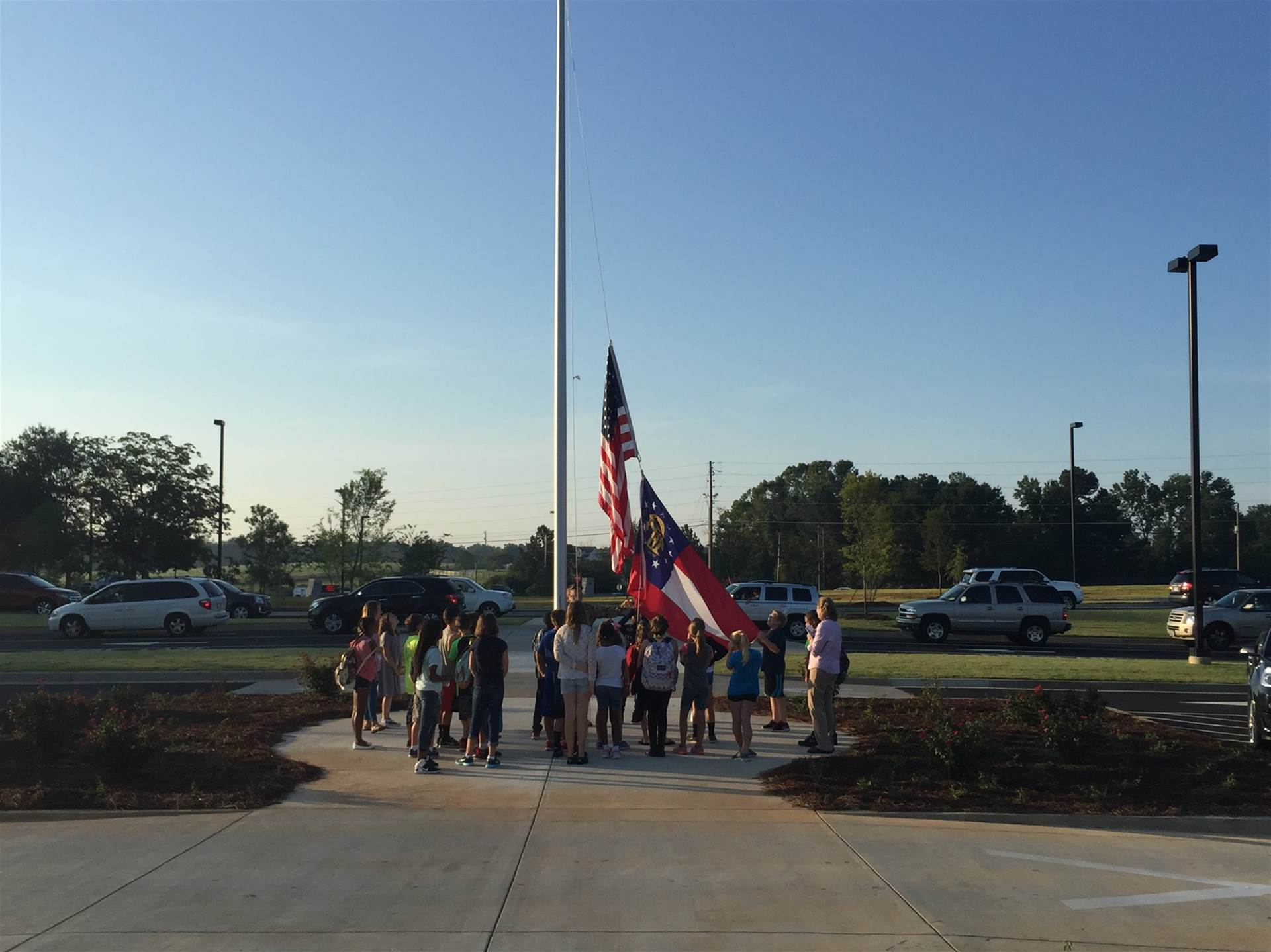 Safety Patrol students raising the school flag.