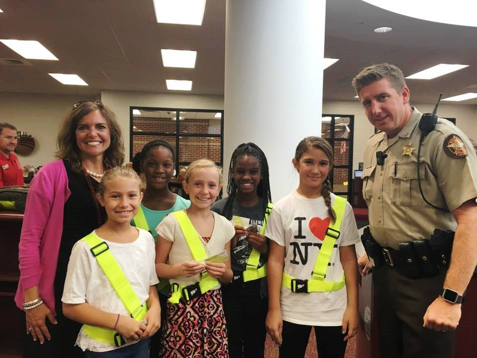 Safety Patrol with an officer and LES's principal.