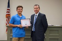 LHS baseball player with superintendent