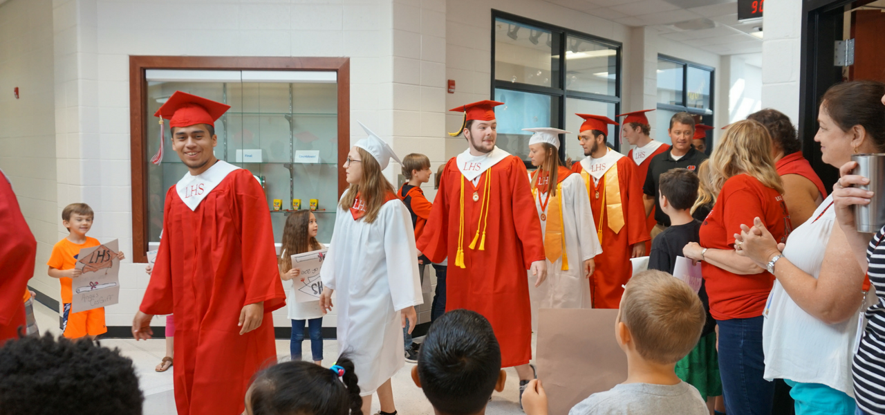 High school seniors walking through Loganville Elementary School