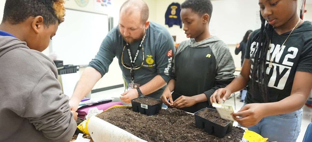 Students starting seedlings in Agriculture class.