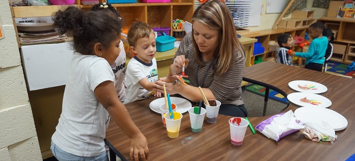 Bay Creek para and students painting