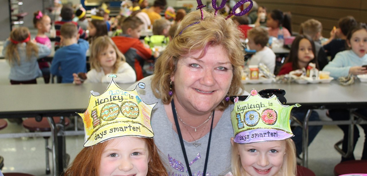Mrs. Moore and her friends celebrating 100 days of school.