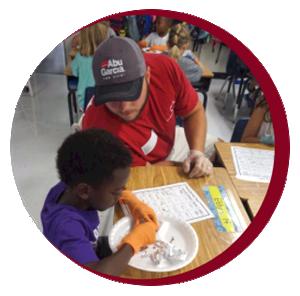 Parent volunteering in a classroom.